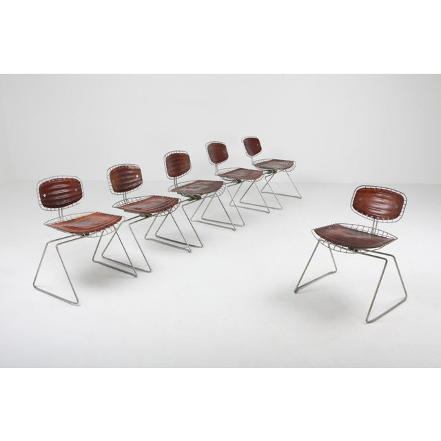 Mid-Century Modern Beaubourg wire chairs by Michel Cadestin and Georges Laurent. These chairs were designed in 1976 for...