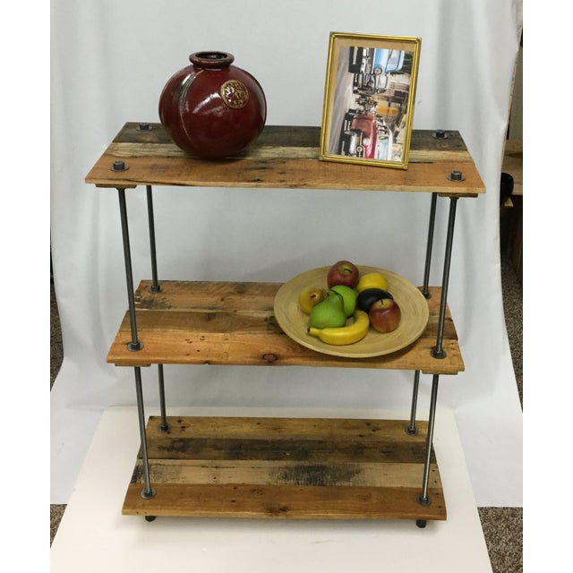 We create these cool adjustable shelves using beautiful vintage hardwood boards taken from decade-old shipping pallets. We...