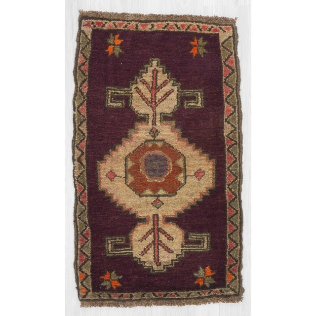 Handknotted mini rug from Kars region of Turkey. In very good condition