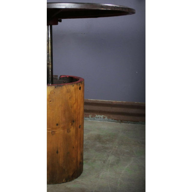 """This heavy duty table was repurposed from an Vintage sander. The top is all steel and measures 40"""" in diameter and sits at..."""