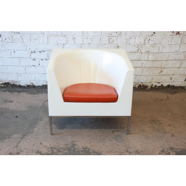Offering a nice Massimo Vignelli style cube chair with orange upholstered cushion. The white molded cube chair rests on a...