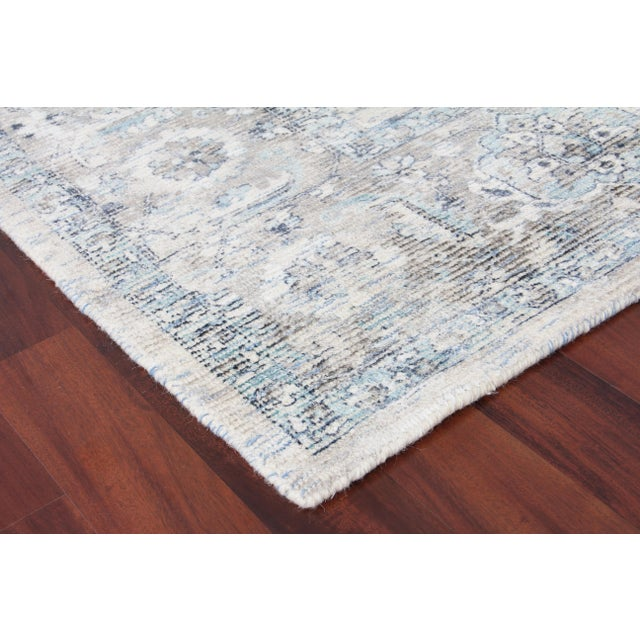 Make a statement with this dreamy accent rug. Handmade with wool and viscose, the Biron rug blends a touch of old-world...