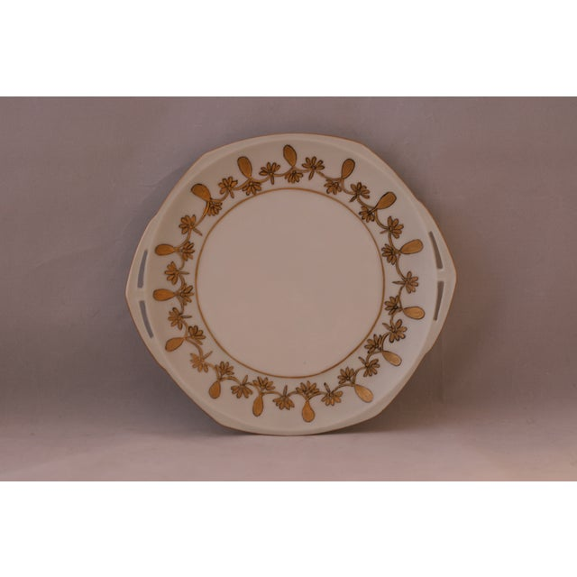 Produced in Austria during the period 1884–1909. Lovely 8 sided white plate with gold detail and cut out handles. Marked...