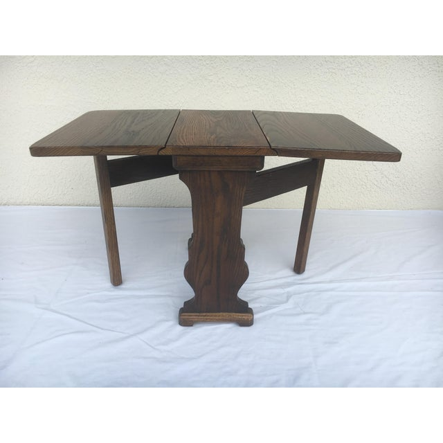 This is a cute x-small stand or table that would accent any room and help in saving space. When the leaves are down the...