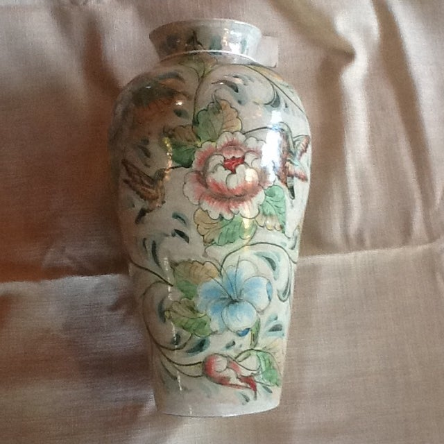 This Mexican ceramic vase would be a great table top center piece or lovely side accent vase. It is a versatile ceramic...