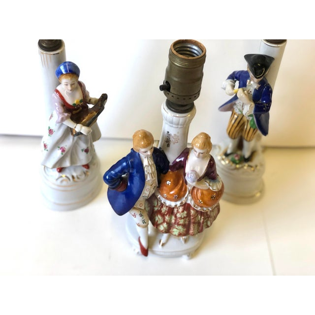 This is a charming and fun set of petite porcelain lamps made in the Old Paris style! One lamp features a French noble...