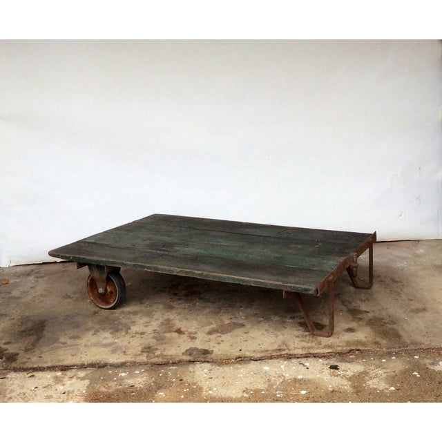 Add some vintage Americana to your home with this authentic industrial railroad cart. This piece has cast iron wheels on...