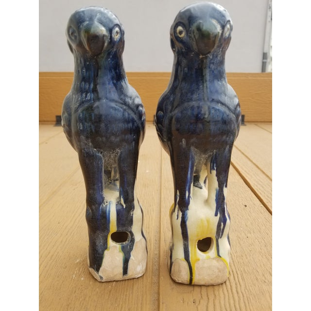 A pair of blue Chinese majolica temple roof finials. Vintage. pterry with a drippy majolica glaze finish.