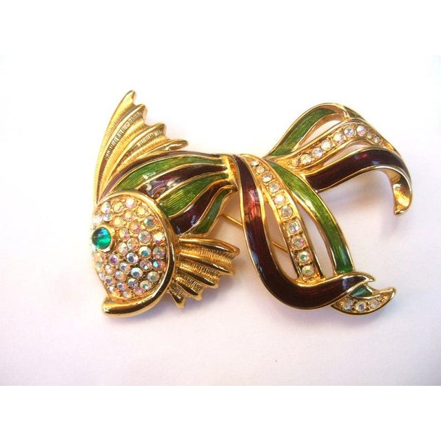 TRIFARI Opulent jeweled enamel gilt metal fish brooch c 1990s The large scale gilt metal stylized fish brooch is...
