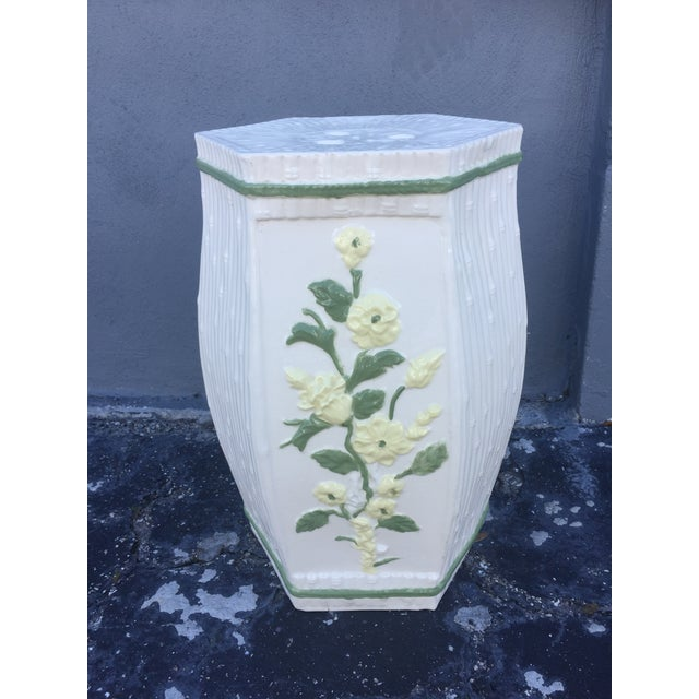 Ceramic garden stool features bright yellow and green floral relief and bamboo detailing. Glazed in a glossy finish....