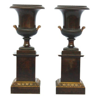 Pair of Gilt and Patinated Bronze Urns