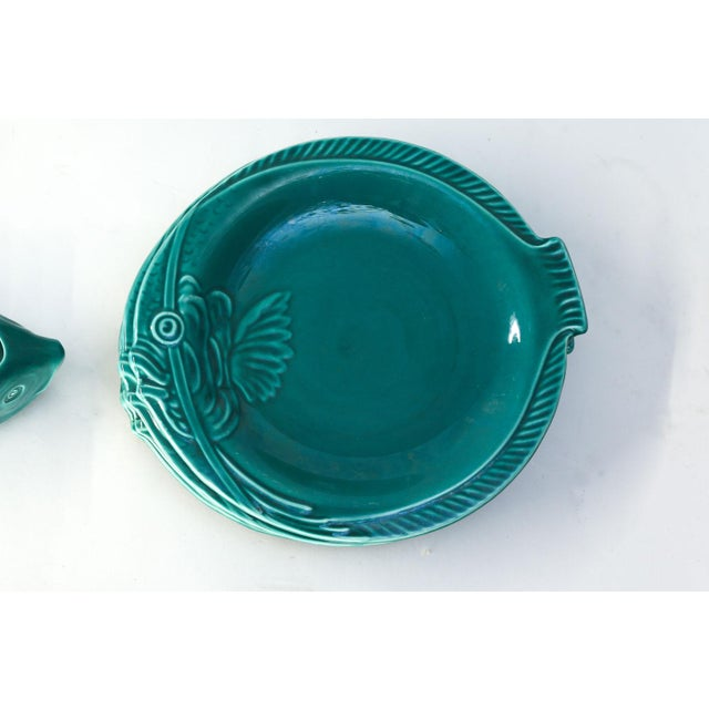 Set of teal fish-shape ceramic dishware from the South of France: ten plates, one round platter, one long large platter...