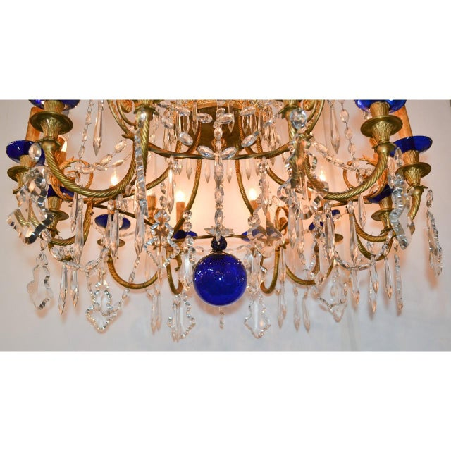 Rare and very fine pair of 19th century Russian chandeliers of gold-gilded bronze, cut crystal, and cobalt blue glass. The...