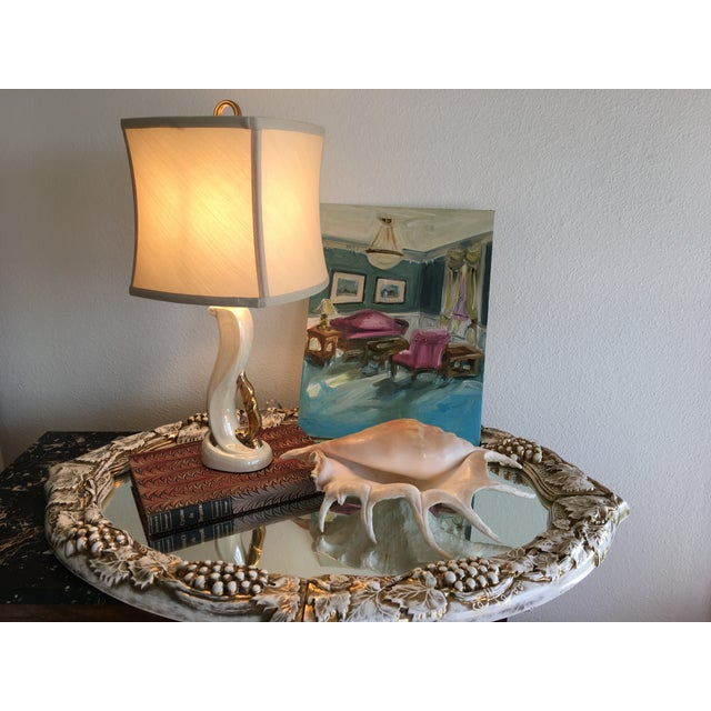 Glamorous pair of 1950s opalescent glazed ceramic boudoir lamps by Aladdin with scrolled necks and gold accents. Marked...