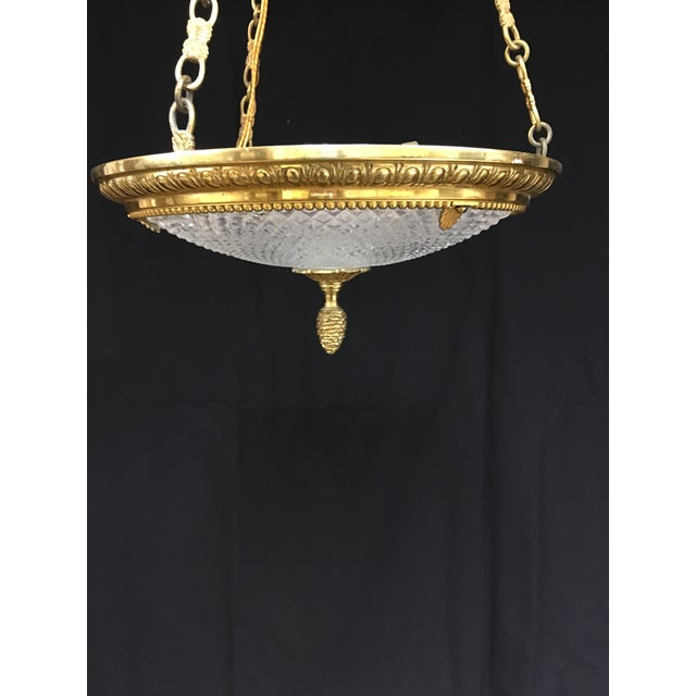 This is a lovely brass and cut crystal French Empire style chandelier. The lower portion is 11.5 inches in diameter, the...