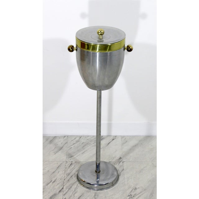 For your consideration is an original, Art Deco, chrome and brass, champagne or ice standing cooler. In excellent...