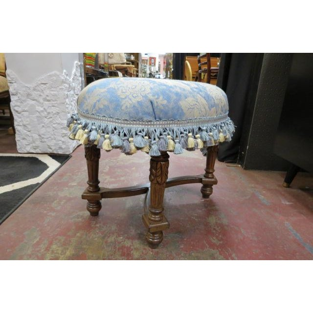 4 fluted round, tapered legs with carved curved stretchers, which cross in the center. Turned feet. Pretty blue and cream...