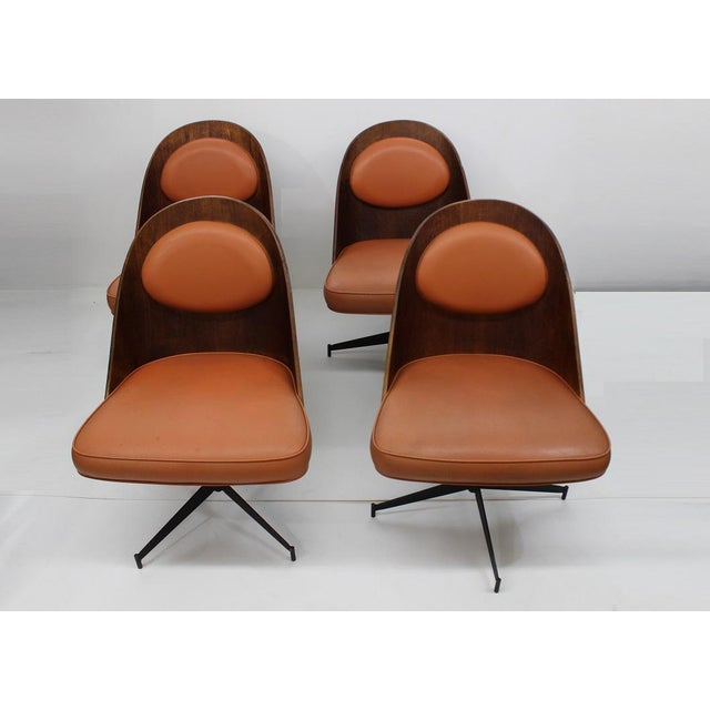 These beautiful dining chairs come to you with a beautiful body made of bent plywood and upholstered seats with orange...