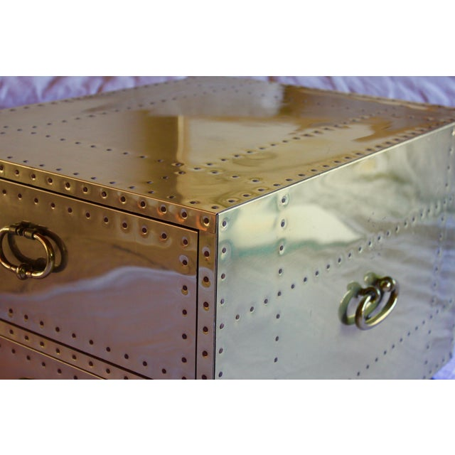 Gorgeous original 1970s brass clad, studded chest with wood feet from the Spanish company Sarreid, Ltd. Two big, deep...