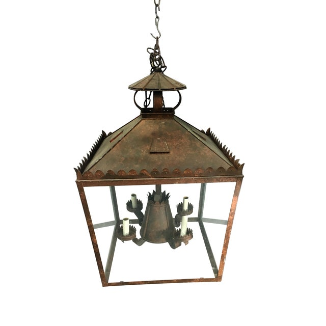 Medieval in feeling this lantern adorned with special metalwork in the form of petals. Light bulb holders continue with...
