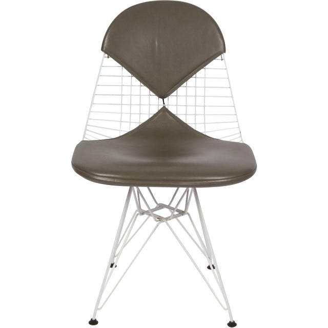 Vintage Eames DKR chairs with gray leather bikini pads produced for Herman Miller, 1980's.