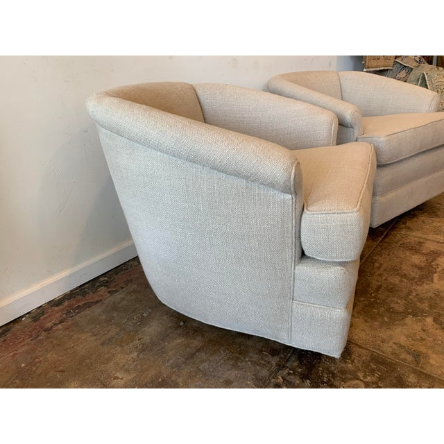 Super comfortable pair of curved back swivel chairs in a soothing natural shade, Belgian Linen fabric.
