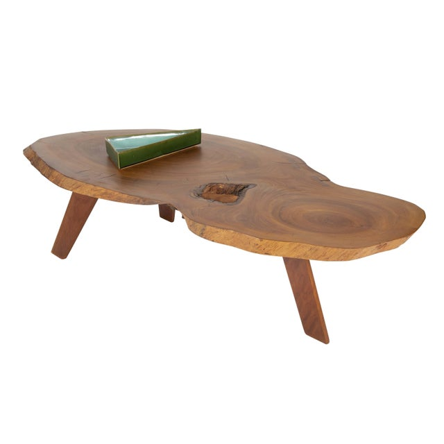 Fine custom made and one-of-a-kind Nakashima style coffee table. This table of commanding size displays the 'inherent and...