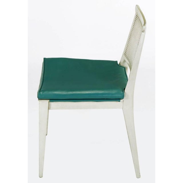Bleched and off-white glazed mahogany side chair #4632, with turquoise vinyl covered seat and caned back by Edward Wormley...