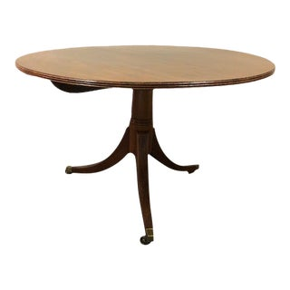 Vintage Mahogany Round Top Table With Brass Feet For Sale