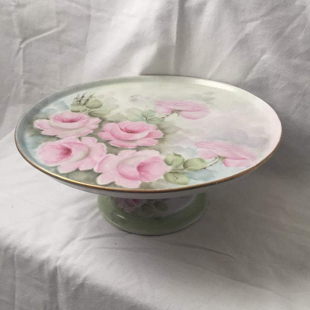 Beautiful hand painted rose pictorial cake plate pedestal. In good condition, some glue shows from where the base was...
