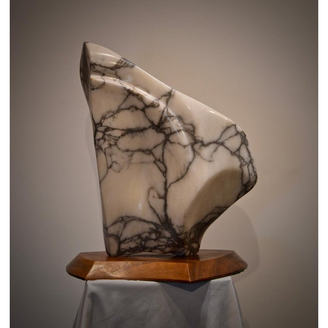 A striking modernist marble sculpture on custom walnut plinth base stand. The esoteric and calm movement of the hand...
