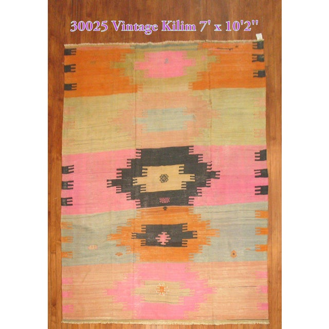 Chic Turkish kilim with all different type of funky colors.