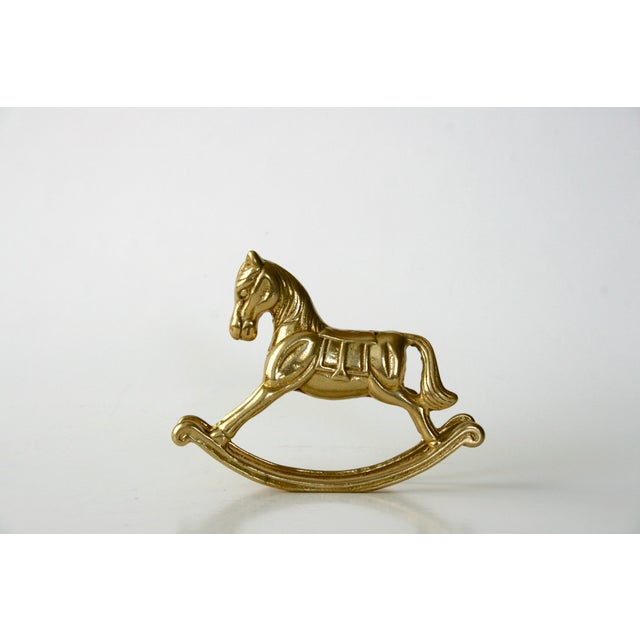 "Adorable vintage solid brass rocking horse. Terrific to add to a ""brass menagerie"" or a sweet additional to a nursery."