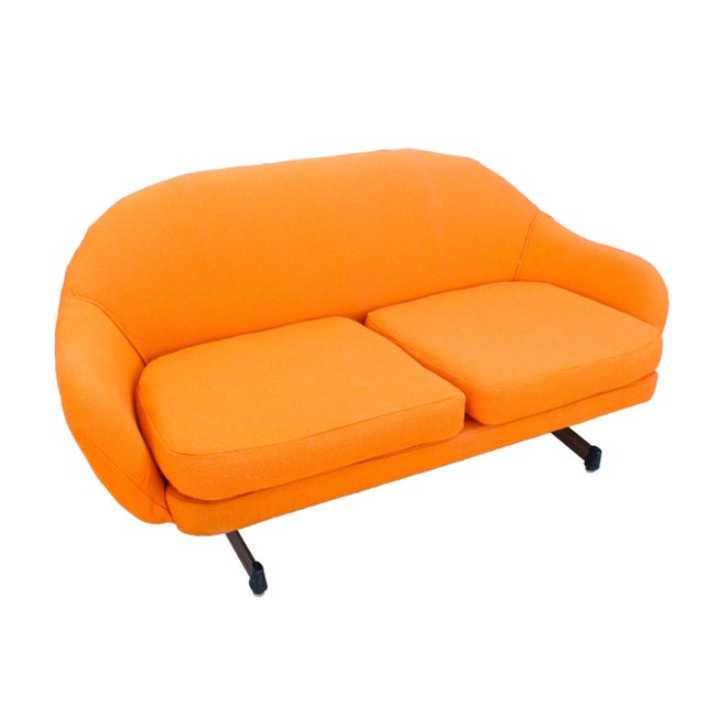 "This two-cushion love seat is low flying as the seat height measures at 15.5"", back height 26"", and just under 5' wide at..."