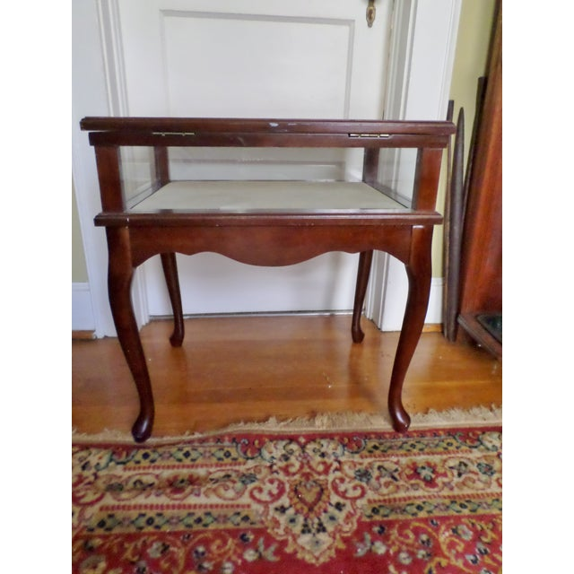 """This is a vintage Bombay Company cherry + glass curio jewelry display case table that is 24.5"""" tall and 22.5"""" long and..."""