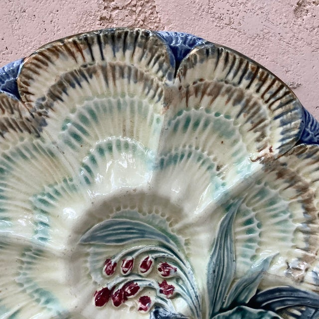 19th century Majolica oyster plate Wasmuel ( Belgium ) decorated with flowers.