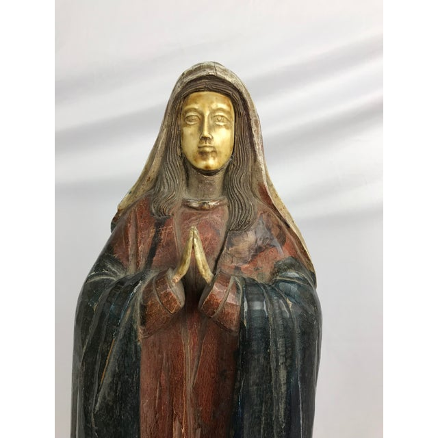 Carved wood, gesso and paint praying woman saint figure or Madonna. Face, hands and feet are carved bone. In good...