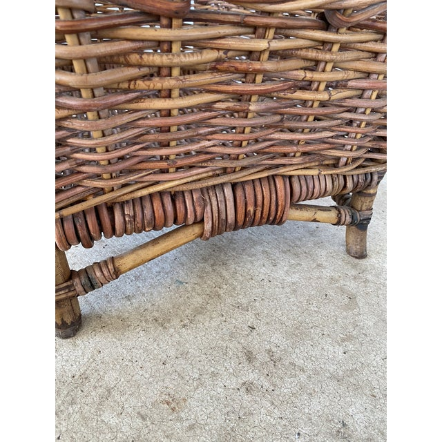 Vintage large braid wicker basket with handle that would be great next to a fireplace holding logs. Please zoom in on all...