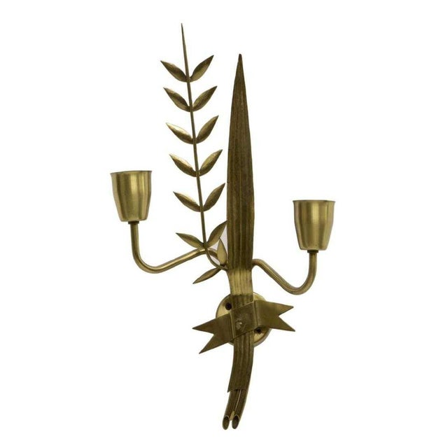 Fabulous French modern brass two-light wall sconce from the 1940's. This statement piece features two arms issuing from a...