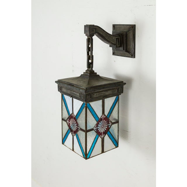 Arts & Crafts Blue, White & Deep Red Stained Glass & Bronze Lantern Sconce For Sale - Image 3 of 12