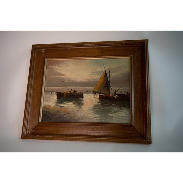 A beautiful vintage oil on canvas-wrapped board depicting sailboats at sunset. Lovely colors, good condition. Frame has...