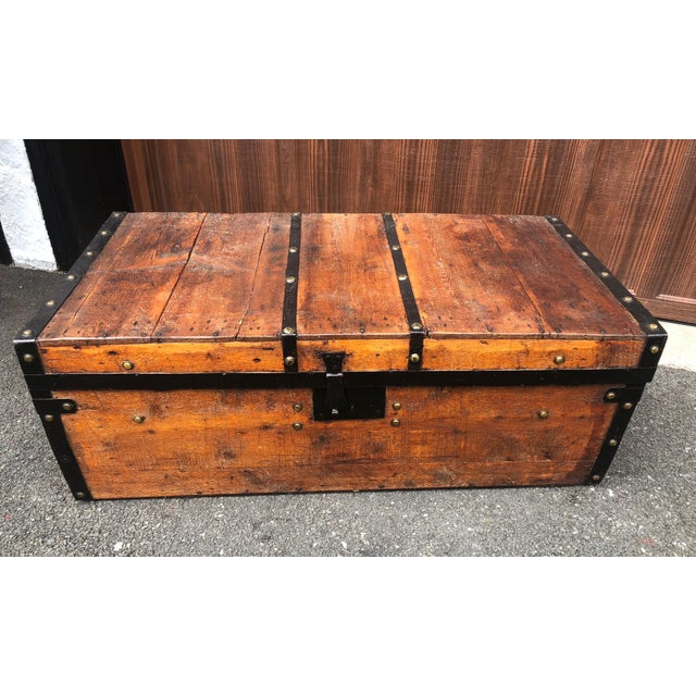 Early 19th century pine trunk. Wonderfully constructed with a nice patina, this trunk features wrought iron detailing and...