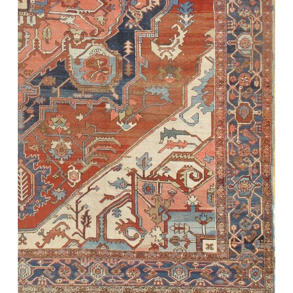 Dating back to the 1880's, this antique Persian Serapi rug is of Persian origins and features gorgeous colors sure to...