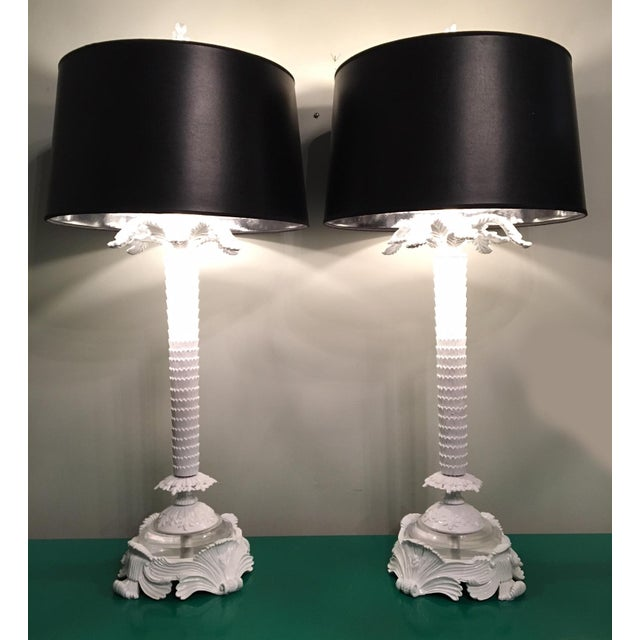 Pair of large hand-carved palm tree table lamps featuring lucite base accents. Perfect for your Hollywood Regency decor!...
