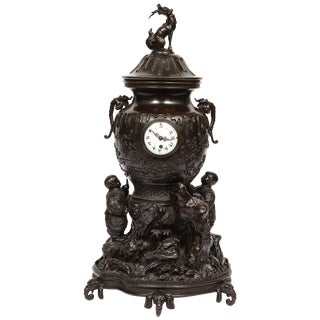 Japanese Patinated Bronze Figural Clock Vase, Meiji Period For Sale