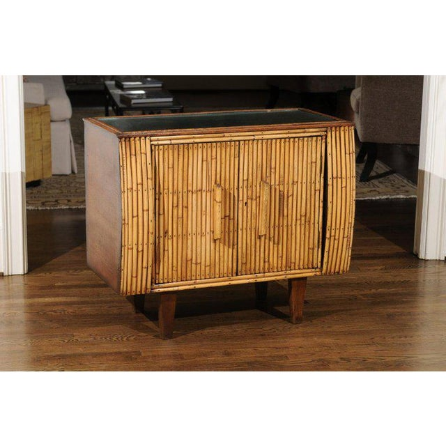 An exquisite Art Deco cabinet, France, circa 1940. Expertly crafted oak construction with a subtle bullnose case detail...