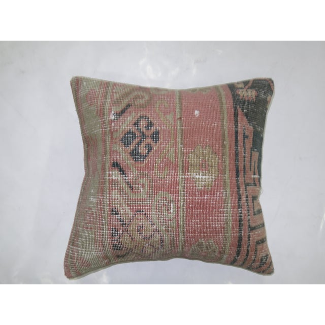 Pillow made from a 19th-century antique khotan rug with cotton back. Zipper closure and foam insert provided.
