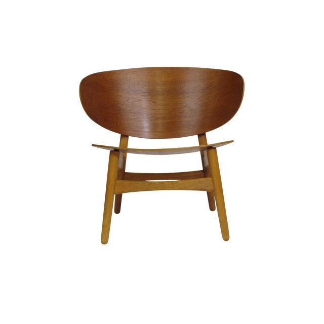Early Hans Wegner Shell Chair by Fritz Hansen, Model FH-1936. originally purchased in Denmark, 1949. Teak shell back and...