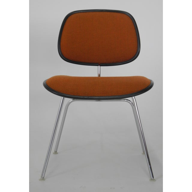 The upholstered Herman Miller DCM chair (known later as the DCMU) adds a comfort to the original plywood version giving it...