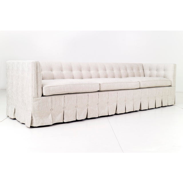 Adeline Stuckey for Kittinger modern, 7000 series biscuit-tufted back and arms Chesterfield sofa, with pleated skirt....